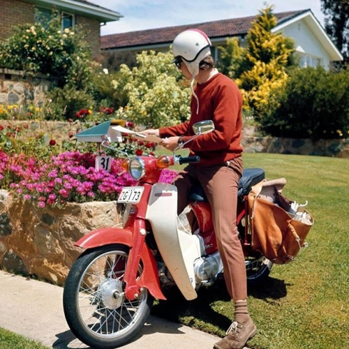 The uniforms may have changed since the 70s, but great service never goes out of style at @auspost! . . . #throwback #70sfashion #scooter #auspost #postie #gungahlin #gungahlinvillage #canberra